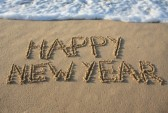 10444199-happy-new-year-written-in-the-sand